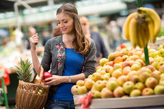 Young woman buying fruit at the market Stock Image