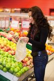 Young woman buying fruits Royalty Free Stock Photos