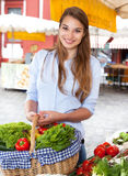 Young woman buying fruits and vegetables Royalty Free Stock Photos