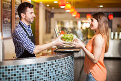 Young woman buying a healthy meal Royalty Free Stock Image