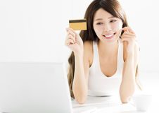 Young Woman buying on line with credit card Stock Image