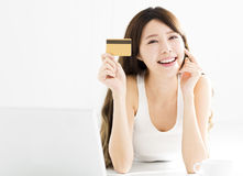 Young Woman buying on line with credit card Royalty Free Stock Photos