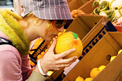 Young woman buying a melon Royalty Free Stock Photo