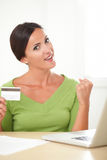 Young woman buying online while celebrating Stock Photography