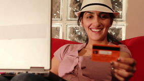 young woman buying online with credit card stock footage