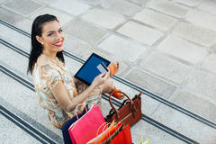Young woman buying online through a digital tablet Stock Images