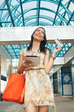 Young woman buying online through a digital tablet Royalty Free Stock Photos