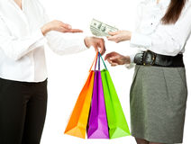 Young woman buying something and paying money Royalty Free Stock Image
