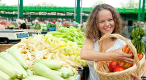 Young Woman Buying Vegetables at Grocery. Market Stock Photo