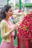 Young woman buying vegetables on the market Stock Photos