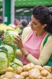 Young woman buying vegetables on the market Stock Photo