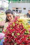 Young woman buying vegetables on the market Royalty Free Stock Image