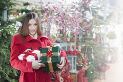 Young woman buys christmas gifts Stock Photos