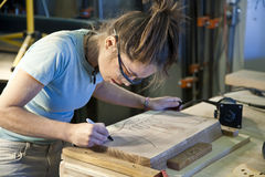 Young woman cabinet making. Royalty Free Stock Photo
