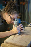 Young woman cabinet making. Stock Images