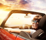 Young woman in cabriolet car near sea royalty free stock photos