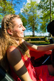 Young woman with cabriolet in summer on day trip Royalty Free Stock Photo