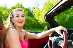 Young woman with cabriolet in summer on day trip Royalty Free Stock Photos