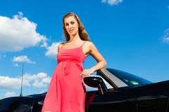 Young woman with cabriolet in summer on day trip Stock Images