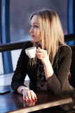 Young woman  in the cafe Royalty Free Stock Photography
