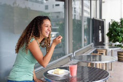 Young woman at cafe eating cake Stock Photo