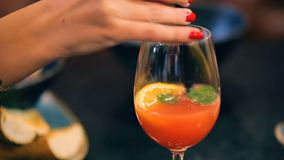 Young woman in cafe enjoying fresh juice coctail stock footage