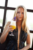 Young woman in cafe with fresh cocktail Stock Images