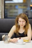 Young woman in a cafe Royalty Free Stock Photos
