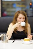 Young woman in a cafe Royalty Free Stock Image