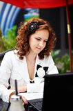 Young woman in cafe with laptop Stock Image