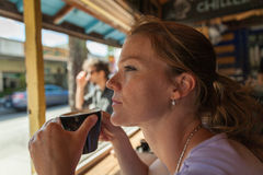Young woman on a cafe terrace in the summer Stock Images