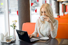 Young woman in Cafe Stock Image