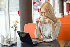 Young woman in Cafe royalty free stock image