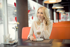 Young woman in Cafe Royalty Free Stock Photos