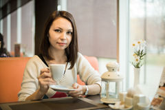 Young woman in Cafe Royalty Free Stock Images