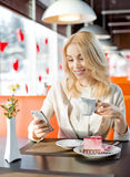 Young woman in Cafe. Very beautiful, happy,  young woman, sit in  Cafe with telephone, vertical portrait Stock Images