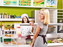 Young woman at cafeteria. Stock Photo