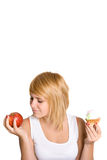 Young woman with cake and apple Royalty Free Stock Photography