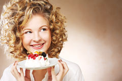 Young woman with a cake Stock Photography