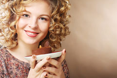 Young woman with a cake Royalty Free Stock Photo