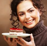 Young woman with a cake Royalty Free Stock Image