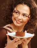 Young woman with a cake Royalty Free Stock Photography