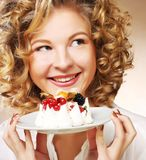 Young woman with a cake Royalty Free Stock Photos