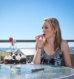 Young woman with cake and champagne Stock Photography