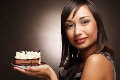 Young woman with a cake and coffee Royalty Free Stock Photo