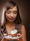 Young woman with a cake and coffee Royalty Free Stock Photography