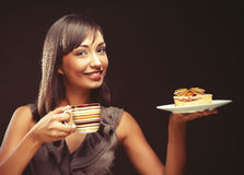 Young woman with a cake and coffee Stock Photography