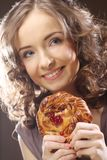 Young woman with a cake Royalty Free Stock Images