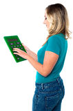 Young woman with calculator Stock Image