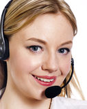 Young woman with a call centre headset Royalty Free Stock Photos